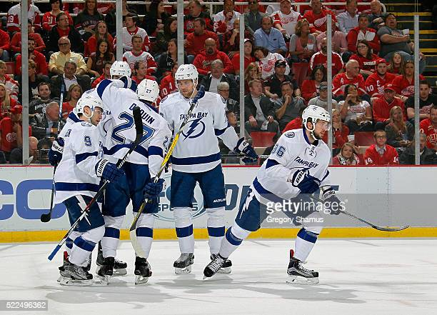 Nikita Kucherov of the Tampa Bay Lightning celebrates his first period goal with teammates while playing the Detroit Red Wings in Game Four of the...