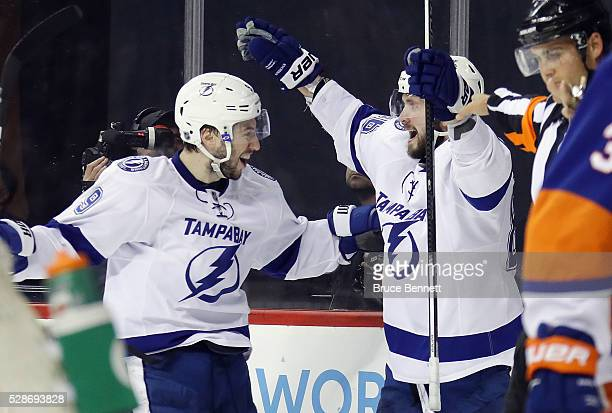 Nikita Kucherov of the Tampa Bay Lightning celebrates his game tying goal at 749 of the third period against the New York Islanders and is joined by...