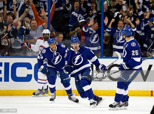 Nikita Kucherov of the Tampa Bay Lightning celebrates his goal between teammates JT Brown and Matt Carle as PK Subban of the Montreal Canadiens...