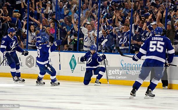 Nikita Kucherov of the Tampa Bay Lightning celebrates his goal against the New York Islanders with Alex Killorn Tyler Johnson and Braydon Coburn...