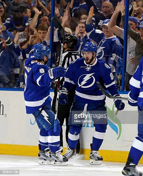 Nikita Kucherov of the Tampa Bay Lightning celebrates his goal against the New York Islanders with teammate Tyler Johnson during the third period of...