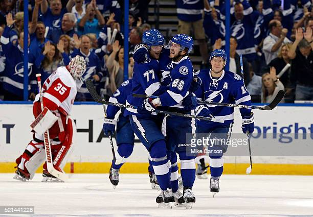 Nikita Kucherov of the Tampa Bay Lightning celebrates his goal with teammate Victor Hedman as goalie Jimmy Howard of the Detroit Red Wings reacts...