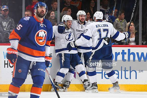 Nikita Kucherov of the Tampa Bay Lightning celebrates his third period goal with Tyler Johnson and Alex Killorn against the New York Islanders in...