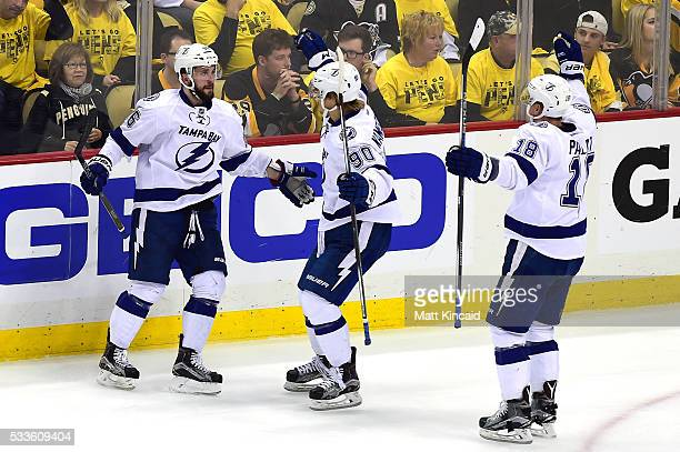 Nikita Kucherov of the Tampa Bay Lightning celebrates with teammates Vladislav Namestnikov and Ondrej Palat after scoring a goal against MarcAndre...