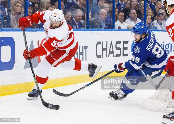 Nikita Kucherov of the Tampa Bay Lightning chases Niklas Kronwall of the Detroit Red Wings during the first period of Game Five of the Eastern...