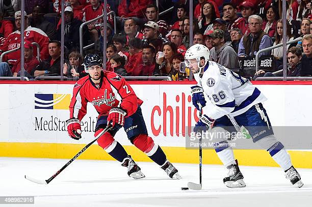 Nikita Kucherov of the Tampa Bay Lightning controls the puck against Matt Niskanen of the Washington Capitals in the first period during an NHL game...