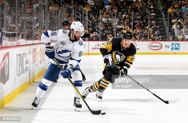 Nikita Kucherov of the Tampa Bay Lightning handles the puck against Carl Hagelin of the Pittsburgh Penguins at PPG Paints Arena on November 25 2017...