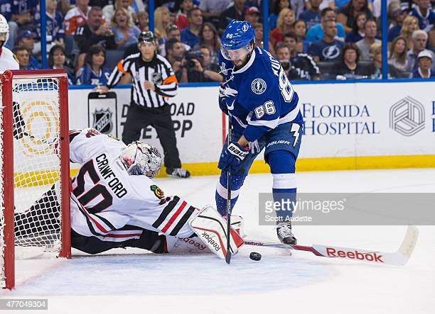 Nikita Kucherov of the Tampa Bay Lightning has his shot blocked by goalie Corey Crawford of the Chicago Blackhawks during the first period in Game...