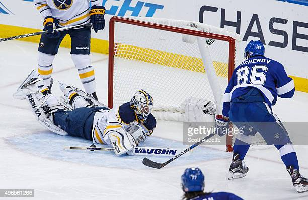Nikita Kucherov of the Tampa Bay Lightning has his shot saved by goalie Chad Johnson of the Buffalo Sabres during second period at the Amalie Arena...