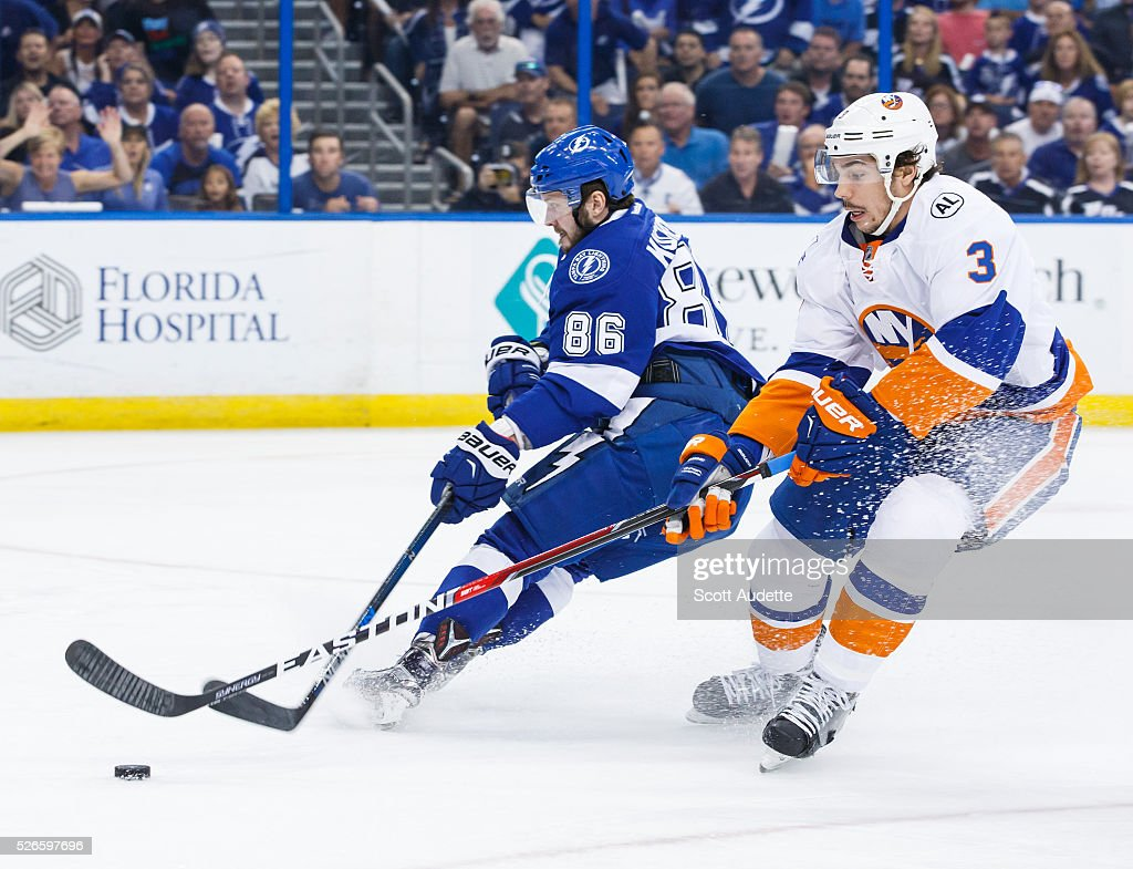 Nikita Kucherov #86 of the Tampa Bay Lightning has the puck stolen by Travis Hamonic #3 of the New York Islanders during the first period of Game Two of the Eastern Conference Second Round in the 2016 NHL Stanley Cup Playoffs at the Amalie Arena on April 30, 2016 in Tampa, Florida.