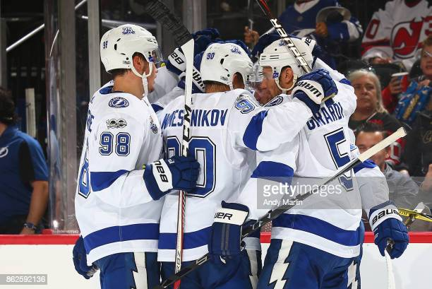 Nikita Kucherov of the Tampa Bay Lightning is congratulated after scoring a goal against the New Jersey Devils during the game at Prudential Center...