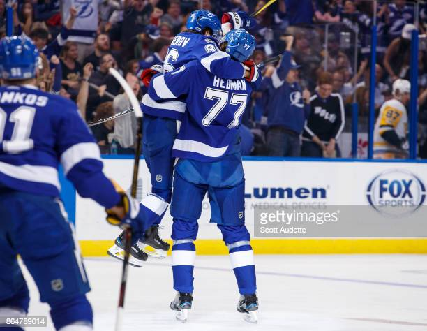 Nikita Kucherov of the Tampa Bay Lightning leaps into the arms of teammate Victor Hedman to celebrate a goal against the Pittsburgh Penguins during...