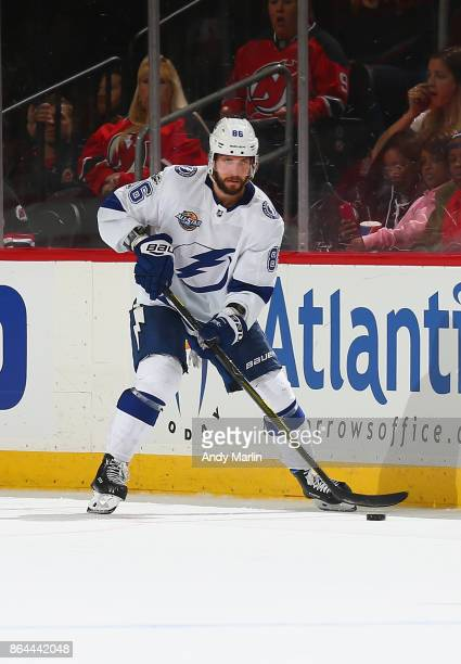 Nikita Kucherov of the Tampa Bay Lightning plays the puck against the New Jersey Devils during the game at Prudential Center on October 17 2017 in...