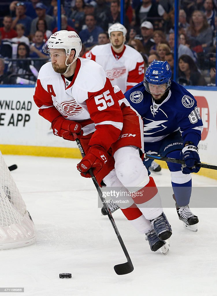 Nikita Kucherov of the Tampa Bay Lightning pursues Niklas Kronwall of the Detroit Red Wings as he circles behind the net with the puck during the...