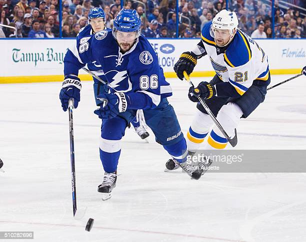 Nikita Kucherov of the Tampa Bay Lightning races for the puck against Patrik Berglund of the St Louis Blues during the third period at the Amalie...