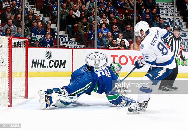 Nikita Kucherov of the Tampa Bay Lightning scores in overtime on Jacob Markstrom of the Vancouver Canucks during their NHL game January 9 2016 in...