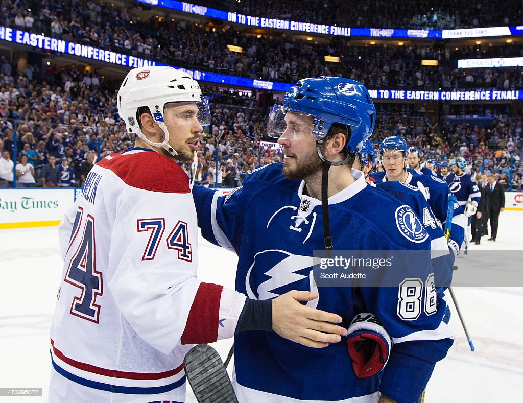 <a gi-track='captionPersonalityLinkClicked' href=/galleries/search?phrase=Nikita+Kucherov&family=editorial&specificpeople=7832285 ng-click='$event.stopPropagation()'>Nikita Kucherov</a> #86 of the Tampa Bay Lightning shakes hands with <a gi-track='captionPersonalityLinkClicked' href=/galleries/search?phrase=Alexei+Emelin&family=editorial&specificpeople=723573 ng-click='$event.stopPropagation()'>Alexei Emelin</a> #74 of the Montreal Canadiens after the series win after Game Six of the Eastern Conference Semifinals during the 2015 NHL Stanley Cup Playoffs at the Amalie Arena on May 12, 2015 in Tampa, Florida.