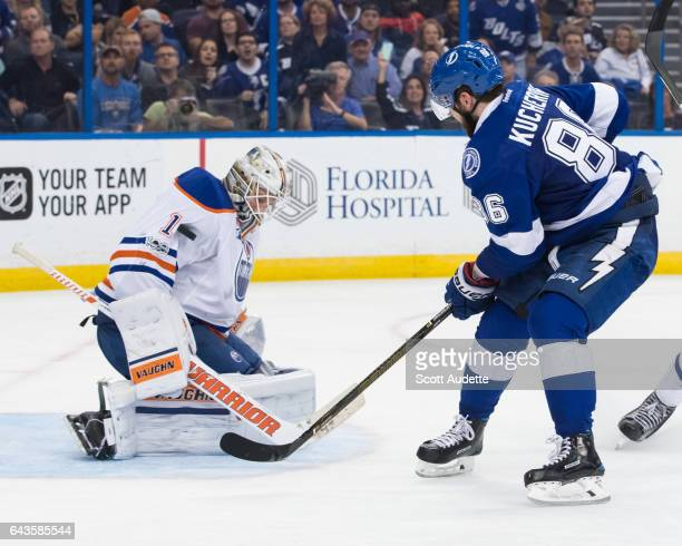 Nikita Kucherov of the Tampa Bay Lightning shoots the puck against goalie Laurent Brossoit of the Edmonton Oilers during the third period at Amalie...