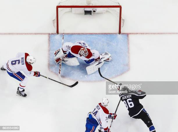 Nikita Kucherov of the Tampa Bay Lightning shoots the puck against goalie Carey Price of the Montreal Canadiens during second period at Amalie Arena...