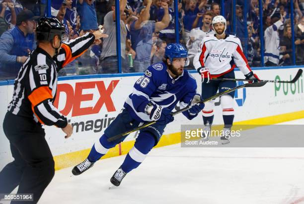 Nikita Kucherov of the Tampa Bay Lightning shoots the puck for a goal against Taylor Chorney and the Washington Capitals during the third period at...