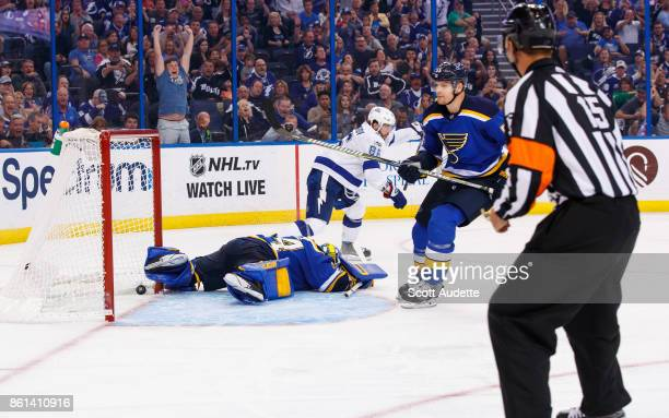 Nikita Kucherov of the Tampa Bay Lightning shoots the puck for a goal against goalie Jake Allen and Colton Parayko of the St Louis Blues during the...