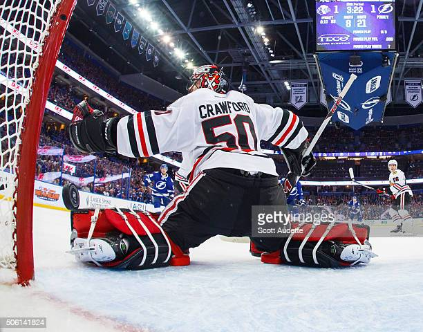 Nikita Kucherov of the Tampa Bay Lightning shoots the puck into the net for a goal against goalie Corey Crawford of the Chicago Blackhawks during the...