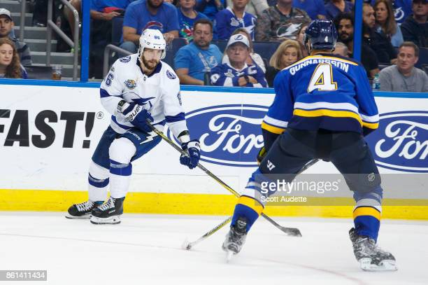 Nikita Kucherov of the Tampa Bay Lightning skates against Carl Gunnarsson of the St Louis Blues during the third period at Amalie Arena on October 14...