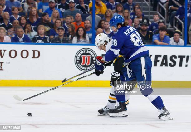 Nikita Kucherov of the Tampa Bay Lightning skates against Evgeni Malkin of the Pittsburgh Penguins during the first period at Amalie Arena on October...