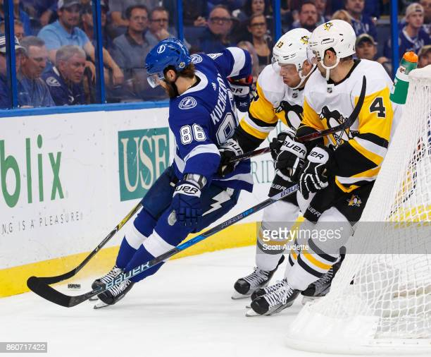Nikita Kucherov of the Tampa Bay Lightning skates against Greg McKegg and Justin Schultz of the Pittsburgh Penguins during the third period at Amalie...