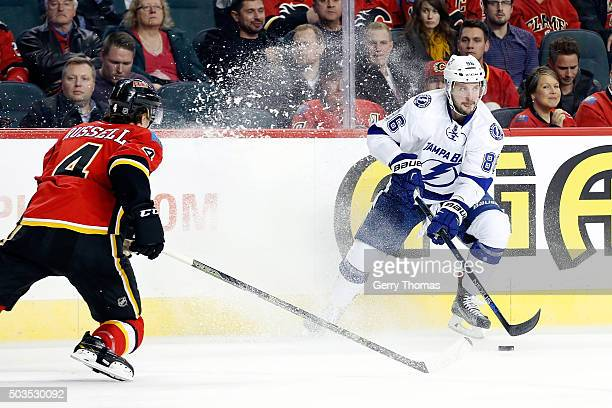 Nikita Kucherov of the Tampa Bay Lightning skates against Kris Russell of the Calgary Flames during an NHL game at Scotiabank Saddledome on January 5...