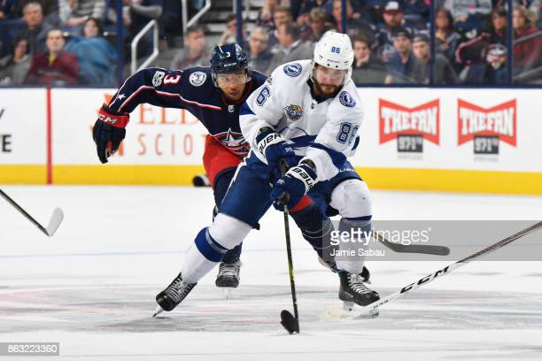Nikita Kucherov of the Tampa Bay Lightning skates the puck away from Seth Jones of the Columbus Blue Jackets during the second period of a game on...