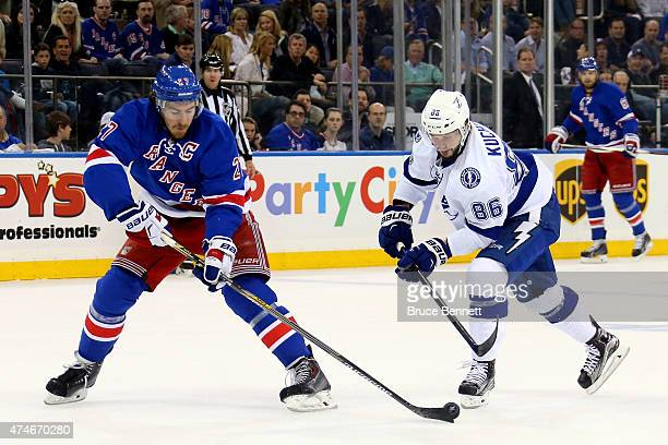 Nikita Kucherov of the Tampa Bay Lightning skates with the puck in the first period as Ryan McDonagh of the New York Rangers defends in Game Five of...