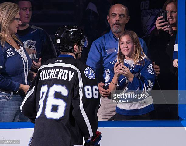 Nikita Kucherov of the Tampa Bay Lightning throws a puck to a young fan after being named one of the stars of the game against the Anaheim Ducks at...