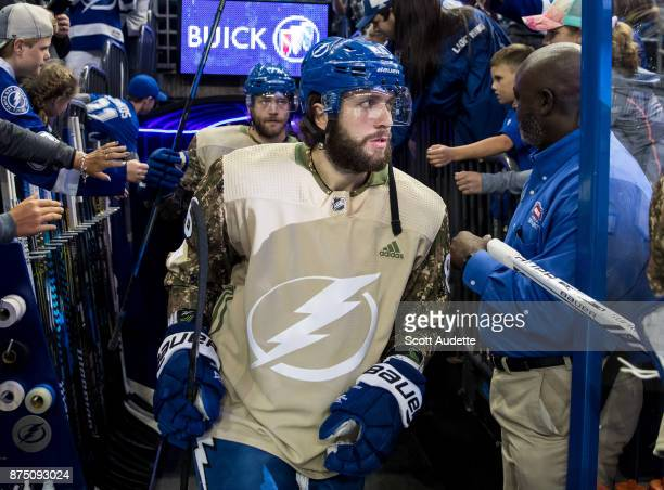 Nikita Kucherov of the Tampa Bay Lightning wears a Military Appreciation Night jersey for pregame warm ups against the Dallas Stars at Amalie Arena...