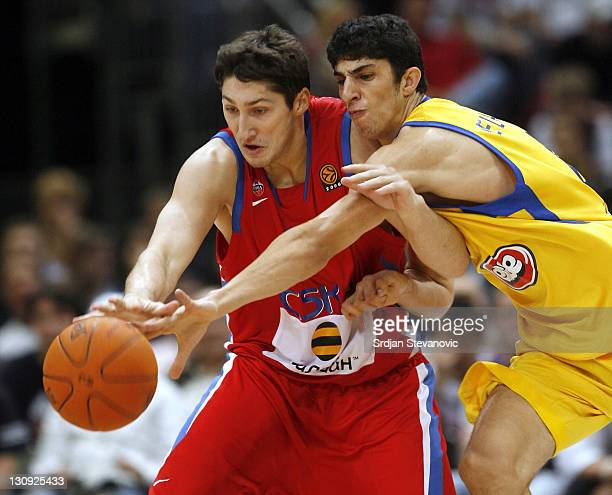 Nikita Kurbanov of CSKA Moscow fight for the ball with Lioir Elyahu of Maccabi Tel Aviv during a NBA Live Tour friendly basketball match between CSKA...