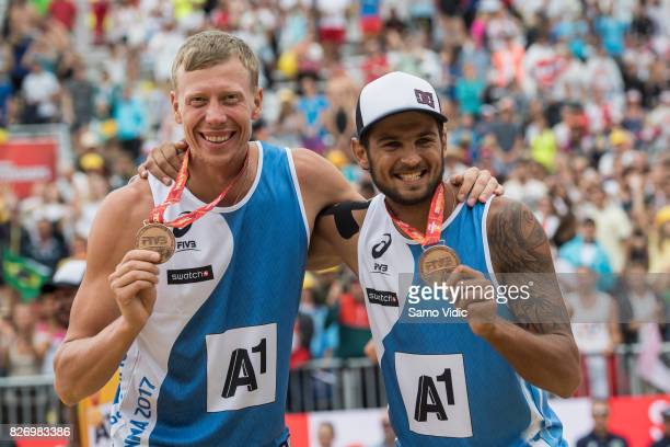 Nikita Liamin and Viacheslav Krasilnikov of Russia celebrate bronze medal at FIVB Beach Volleyball World Championships on August 6 2017 in Vienna...