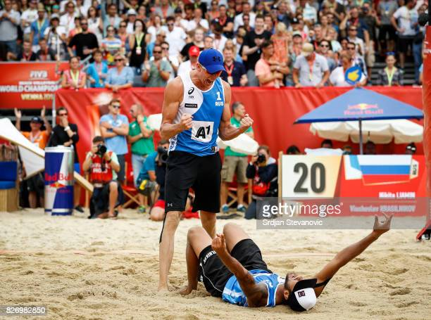 Nikita Liamin and Viacheslav Krasilnikov of Russia celebrate victory after the Men's Bronze medal match between Russia and Netherlands on August 06...