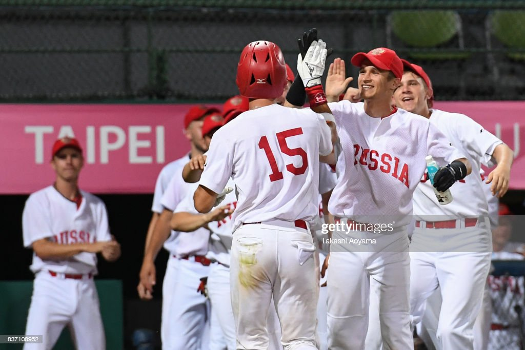 Nikita Monakhov #15 of Russia celebrates with teammates after he hits a solo home run in the second inning during the Baseball Group B match between United States and Russia during day three of the 29th Summer Universiade Taipei at the Xinzhuang Baseball Stadium on August 22, 2017 in Taipei, Taiwan.