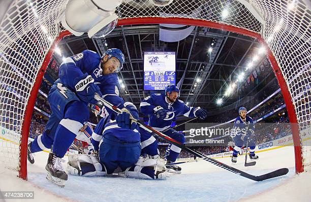Nikita Nesterov Ben Bishop Anton Stralman and Ryan Callahan of the Tampa Bay Lightning defend against the New York Rangers in Game Three of the...
