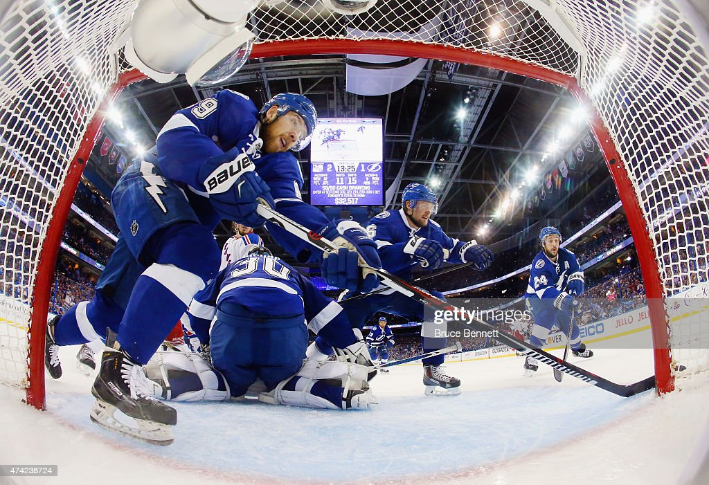 <a gi-track='captionPersonalityLinkClicked' href=/galleries/search?phrase=Nikita+Nesterov&family=editorial&specificpeople=7895381 ng-click='$event.stopPropagation()'>Nikita Nesterov</a> #89, <a gi-track='captionPersonalityLinkClicked' href=/galleries/search?phrase=Ben+Bishop&family=editorial&specificpeople=700137 ng-click='$event.stopPropagation()'>Ben Bishop</a> #30, <a gi-track='captionPersonalityLinkClicked' href=/galleries/search?phrase=Anton+Stralman&family=editorial&specificpeople=2271901 ng-click='$event.stopPropagation()'>Anton Stralman</a> #6 and <a gi-track='captionPersonalityLinkClicked' href=/galleries/search?phrase=Ryan+Callahan&family=editorial&specificpeople=809690 ng-click='$event.stopPropagation()'>Ryan Callahan</a> #24 of the Tampa Bay Lightning defend against the New York Rangers in Game Three of the Eastern Conference Finals during the 2015 NHL Stanley Cup Playoffs at Amalie Arena on May 22, 2015 in Tampa, Florida. The Lightning defeated the Rangers 6-5 in overtime.