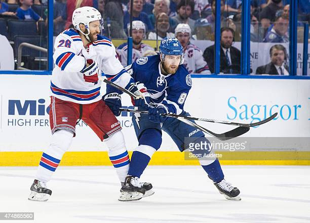 Nikita Nesterov of the Tampa Bay Lightning against Dominic Moore of the New York Rangers during the third period in Game Four of the Eastern...