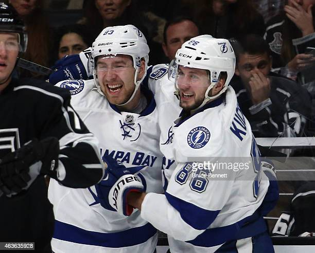 Nikita Nesterov of the Tampa Bay Lightning celebrates his first NHL goal at 1211 of the first period against the Los Angeles Kings and is joined by...