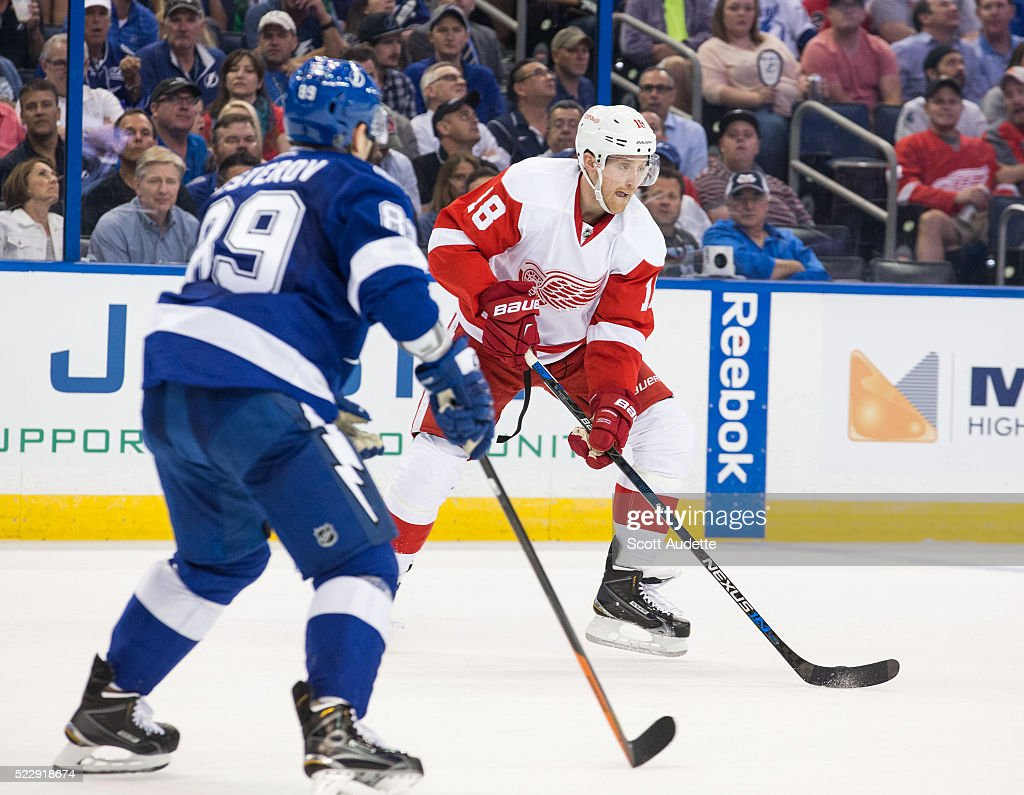 Nikita Nesterov of the Tampa Bay Lightning defends against Joakim Andersson of the Detroit Red Wings during the second period of Game One of the...