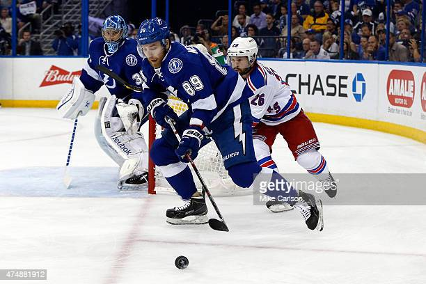 Nikita Nesterov of the Tampa Bay Lightning defends against Martin St Louis of the New York Rangers in Game Six of the Eastern Conference Finals...
