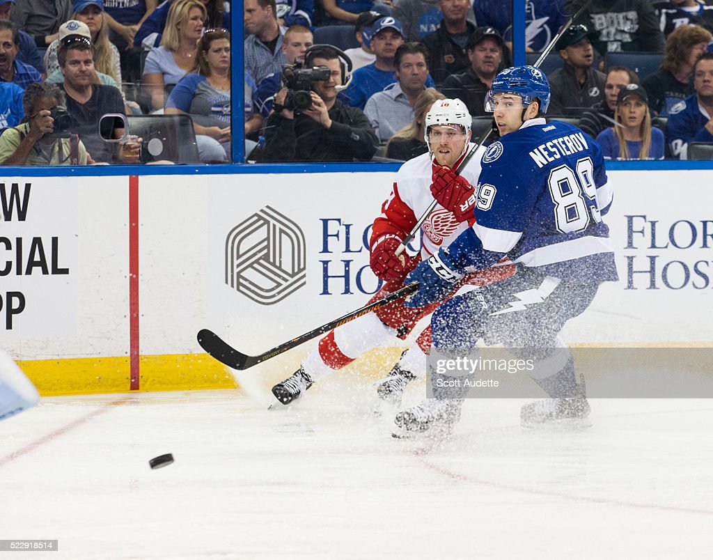 Nikita Nesterov of the Tampa Bay Lightning skates against Joakim Andersson of the Detroit Red Wings during the second period of Game One of the...