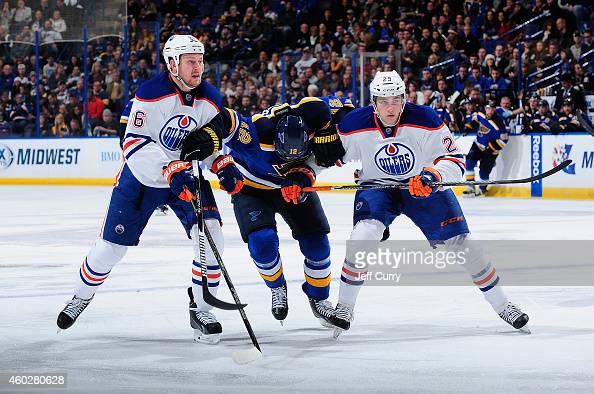 Nikita Nikitin and Leon Draisaitl of the Edmonton Oilers skates against Jori Lehtera of the St Louis Blues on November 28 2014 at Scottrade Center in...