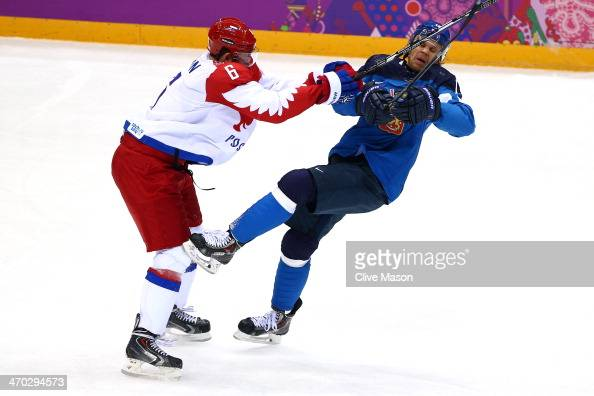 Nikita Nikitin of Russia collides with Olli Jokinen of Finland during the Men's Ice Hockey Quarterfinal Playoff on Day 12 of the 2014 Sochi Winter...
