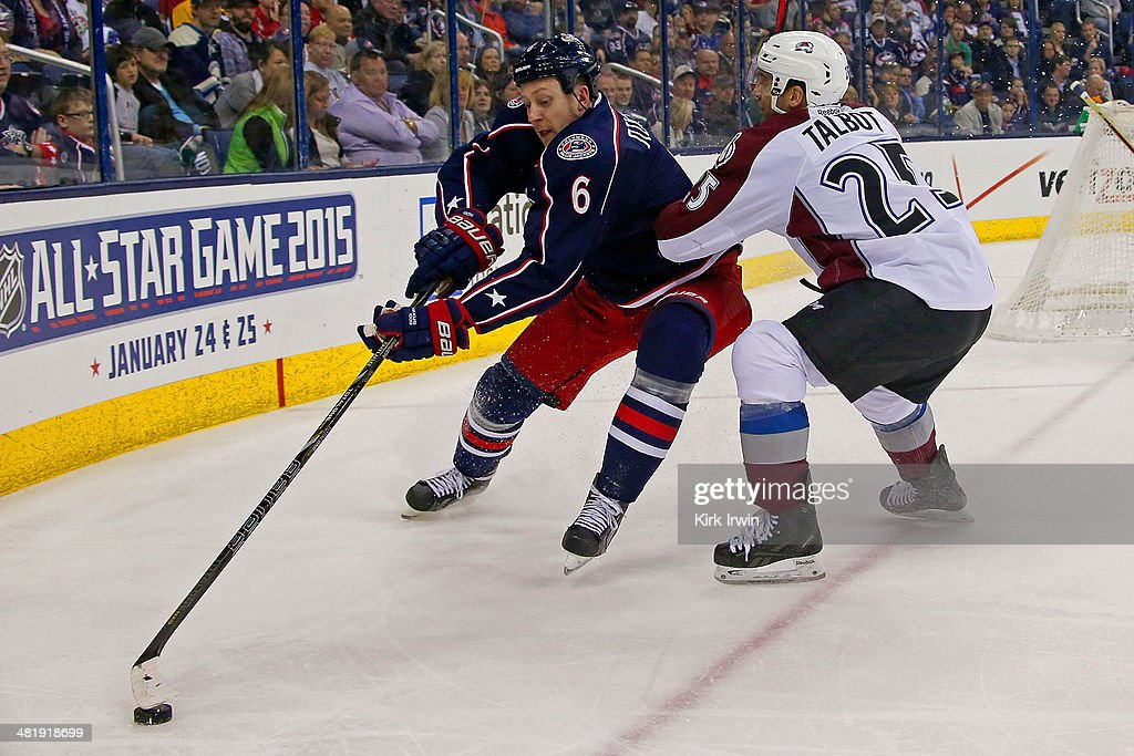 Nikita Nikitin #6 of the Columbus Blue Jackets and Maxime Talbot #25 of the Colorado Avalanche battle for control of the puck during the third period on April 1, 2014 at Nationwide Arena in Columbus, Ohio. Colorado defeated Columbus 3-2 in overtime.