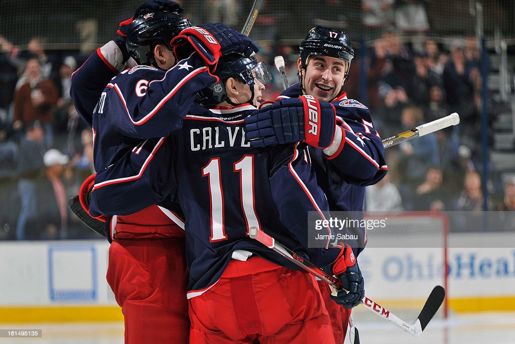 <a gi-track='captionPersonalityLinkClicked' href=/galleries/search?phrase=Nikita+Nikitin&family=editorial&specificpeople=722107 ng-click='$event.stopPropagation()'>Nikita Nikitin</a> #6 of the Columbus Blue Jackets is congratulated by his teammates after scoring a goal during the third period against the San Jose Sharks on February 11, 2013 at Nationwide Arena in Columbus, Ohio. Columbus defeated San Jose 6-2.