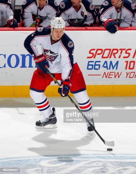 Nikita Nikitin of the Columbus Blue Jackets plays the puck against the New Jersey Devils during the game at the Prudential Center on December 27 2013...